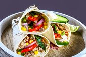 Mexican Restaurant Fast Food - Wrapped Burritos With Pork Meat, Mushrooms And Vegetables Closeup At  poster