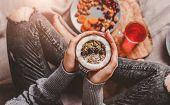 Girls Hands Holding Granola Porridge With Berries, Nuts In Coconut. Healthy Breakfast Ingredients.  poster