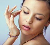 Beautiful woman with jewellery and colourful stones necklace