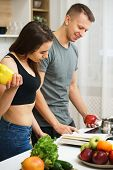 Weight Loss, Keto, Detox, Paleo Diet Food, Slimming And Healthy Lifestyle. Fit Slim Couple Reading R poster