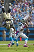 CHARLOTTE, NC - OCT 09, 2011:  Saints Linebacker, Jonathan Vilma, is flipped while Panthers Quaterba