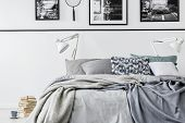 Photo Collector Bedroom With King Size Bed With Grey Bedding And White Lamps, Pile Of Books On The F poster