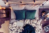 Top View Of Comfortable King Size Bed With Emerald Green Pillows, Fury Duvet And Closed Laptop poster