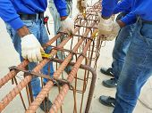 Workers Hands Using Steel Wire For Securing Steel Bars With Wire Rod For Reinforcement, Steel Reinfo poster