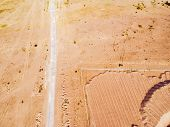 Aerial View Of Road With. Aerial View Of A Country Road With Sand. Car Passing By. Aerial Constructi poster