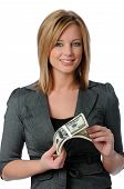 stock photo of holding money  - Beautiful young woman holding a stack of money isolated over white - JPG