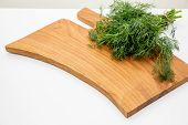 Fresh Garden Dill, Herbs On Wooden Boad. Top View With Copy Space.chopped Fresh Dill On A Cutting Bo poster