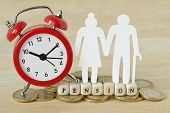 The Word Pension Written With Wooden Blocks, Paper Elderly Couple And Alarm Clock On Coins - Pension poster