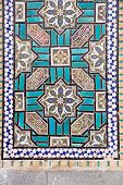 Tiled oriental ornaments on Bohg-e Harun Vilayet Shrine's wall , Esfahan, Iran