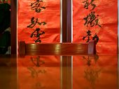 Still Life Of Chinese Restaurant Interior With Red Calligraphy Silkscreen