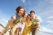 image of summer beach  - Group Of Friends Having Fun On Summer Beach - JPG