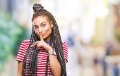 Young braided hair african american girl over isolated background asking to be quiet with finger on  poster