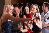 image of night-club  - Young women drinking at bar - JPG