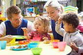 foto of nursery school child  - Couple and children playing with toys - JPG