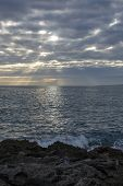 Atmospheric Cloudscape With Sunrays At Sunset In November In Mallorca, Spain. poster