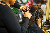 Close Up African Hairstylist Braided Hair Of Afro American Female Client In The Barber Salon. Black  poster