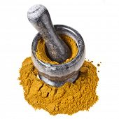 Stone marble mortar and pestle with curry powder isolated on white