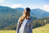 Serenity Young Tourist Woman On Top Of Mountains Contemplating View And Enjoy Freedom poster