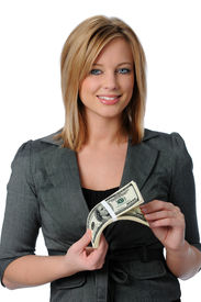 pic of holding money  - Beautiful young woman holding a stack of money isolated over white - JPG