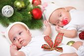 Christmas twin newborn babies in white
