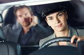 Portrait of female chauffeur in luxury car.