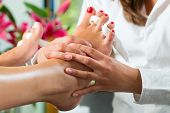 stock photo of pedicure  - Woman receiving pedicure in a Day Spa - JPG