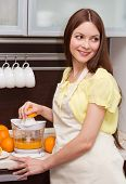 Beautiful Woman Making Orange Juice