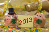 stock photo of talisman  - talisman for new year 2013 and champagne - JPG