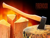 Cut log fire wood and axe. Renewable resource of a energy. Environmental concept.