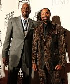 NEW YORK-SEPT. 24: Former basketball players Alonzo Mourning (L) and Walt Frazier attend the 27th Great Sports Legends Dinner at the Waldorf-Astoria on September 24, 2012 in New York City.