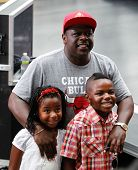 NEW YORK-AUG 14: Comedian Cedric the Entertainer and his children watch Nicki Minaj perform on NBC's
