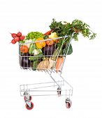 foto of grocery cart  - Shopping cart filled with fresh vegetables  - JPG
