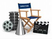 Movie industry. Producer chair, �?�?�?�±lapperboard and film reels. 3d