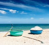stock photo of coracle  - Fishing boats on beach - JPG
