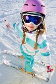 Skiing, winter - kid on ski holidays