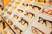 Eyglasses, Shades And Sunglasses In Optometrist's Shop