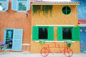 Red Bicycle Infront Of Colorful Building Background