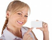 A Woman Holds In Her Hand A Plastic Card For Purchases. On A White Background