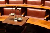 stock photo of justice law  - Symbol of law and justice in the empty courtroom law and justice concept - JPG