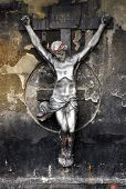 foto of crucifiction  - A statue of Jesus Christ crucified on a cross over a grunge background.