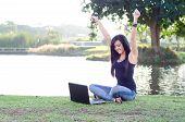 Beautiful teen enjoying technology