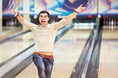 Emotional young man in bowling