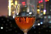 Wine Glass And City Reflex