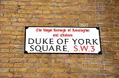 stock photo of duke  - Duke of York square street sign on the side of a building - JPG