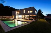 Modern villa with pool, night scene