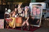 stock photo of gypsy  - Gypsy travellers with truck and table outside - JPG