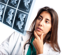 picture of mammogram  - Doctor examining a mammogram - JPG