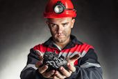 Coalminer Holding Lump Of Coal