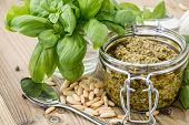 image of pesto sauce  - Pesto Sauce in a Glass on wooden background - JPG
