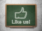 Social media concept: Thumb Up and Like us! on chalkboard background
